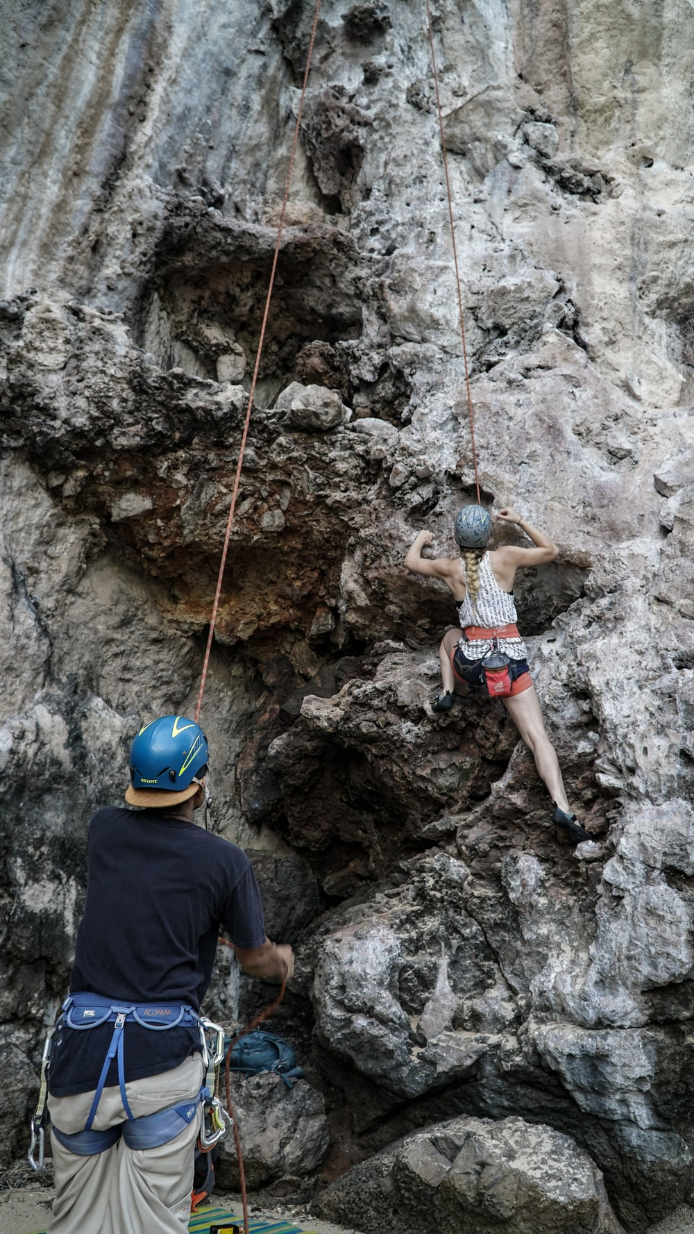 two person climbing on mountain