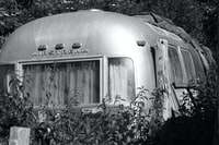 grayscale photography of airstream camper trailer