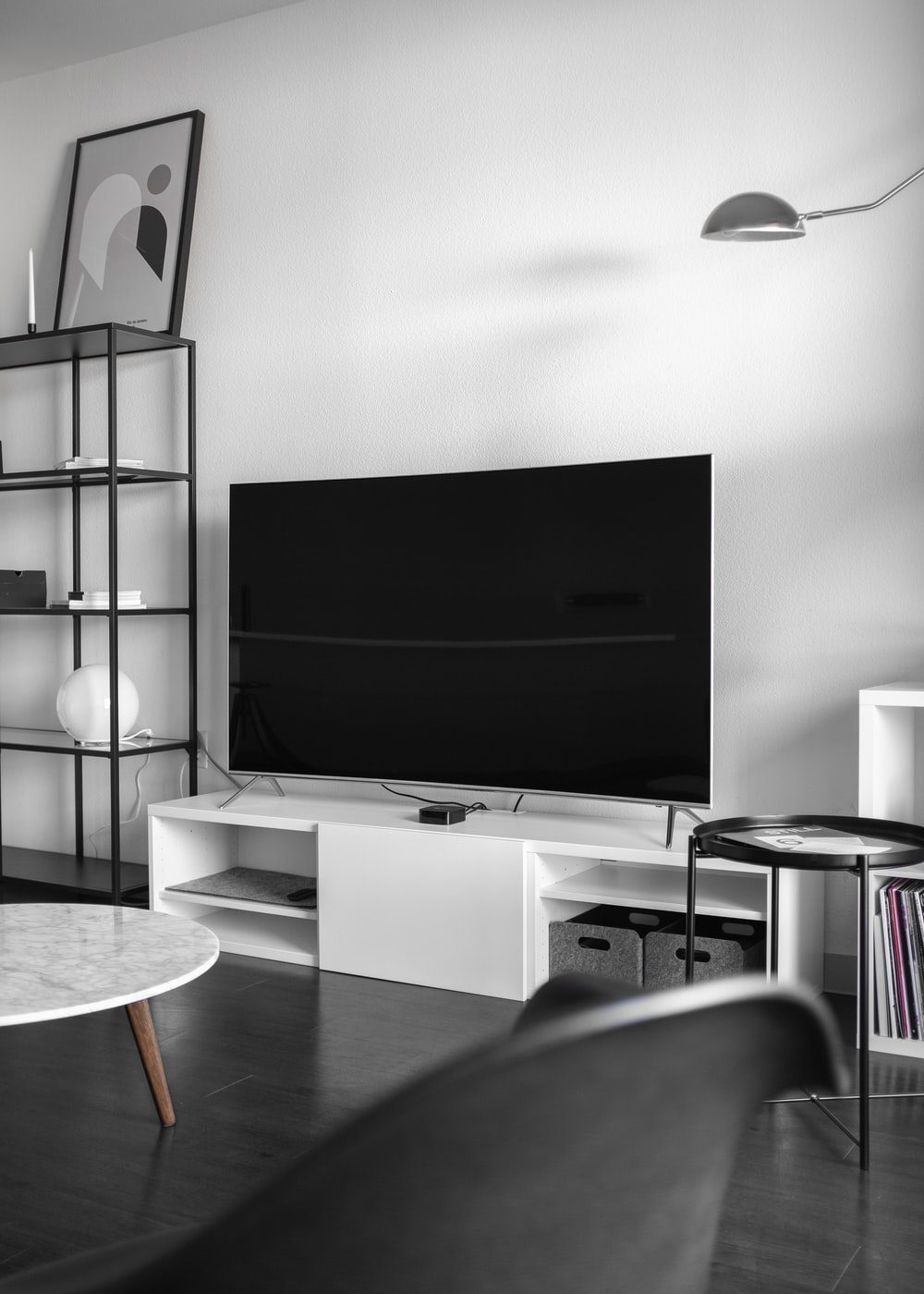 flat screen television on top of white wooden low-line TV stand