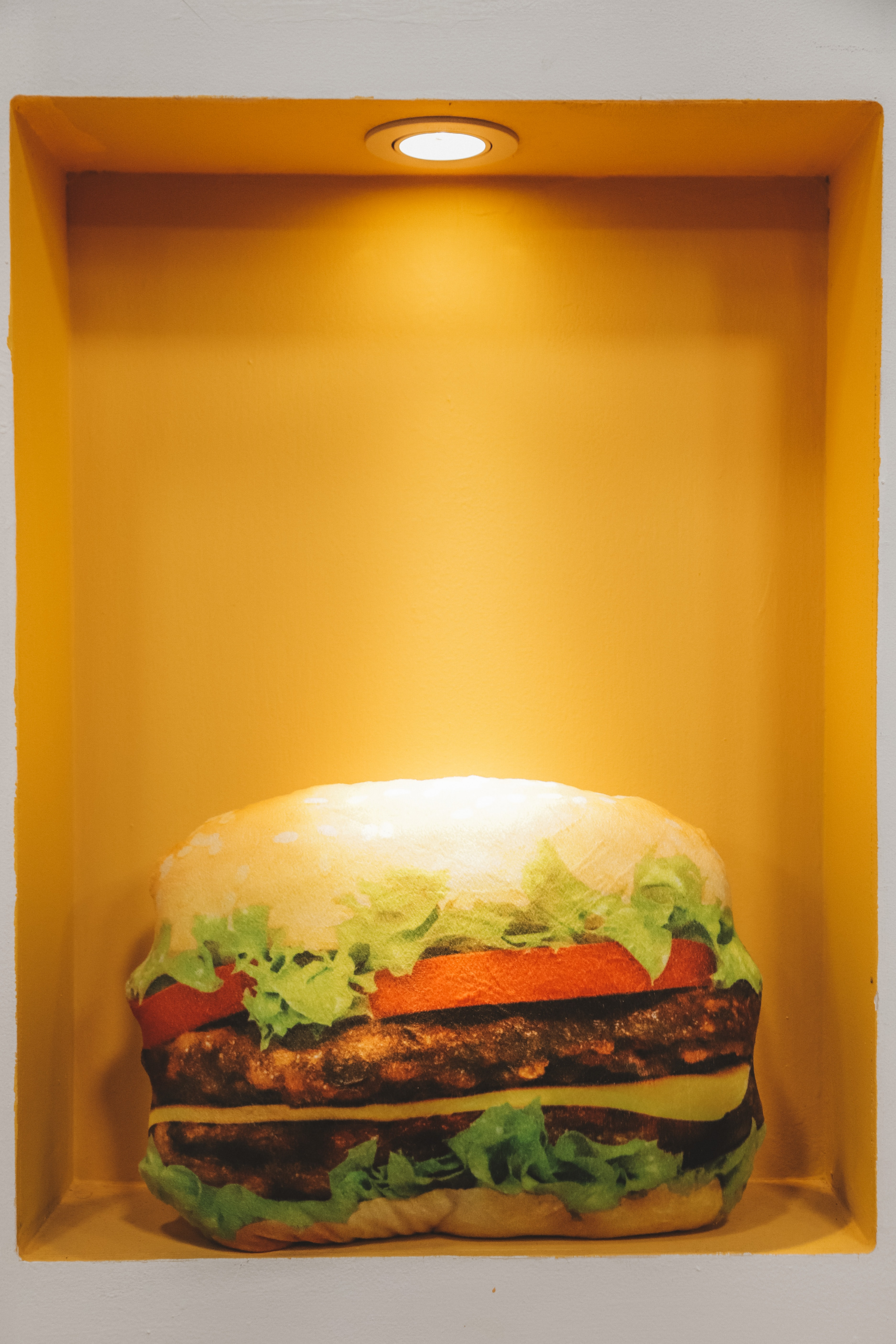 burger displayed on yellow container