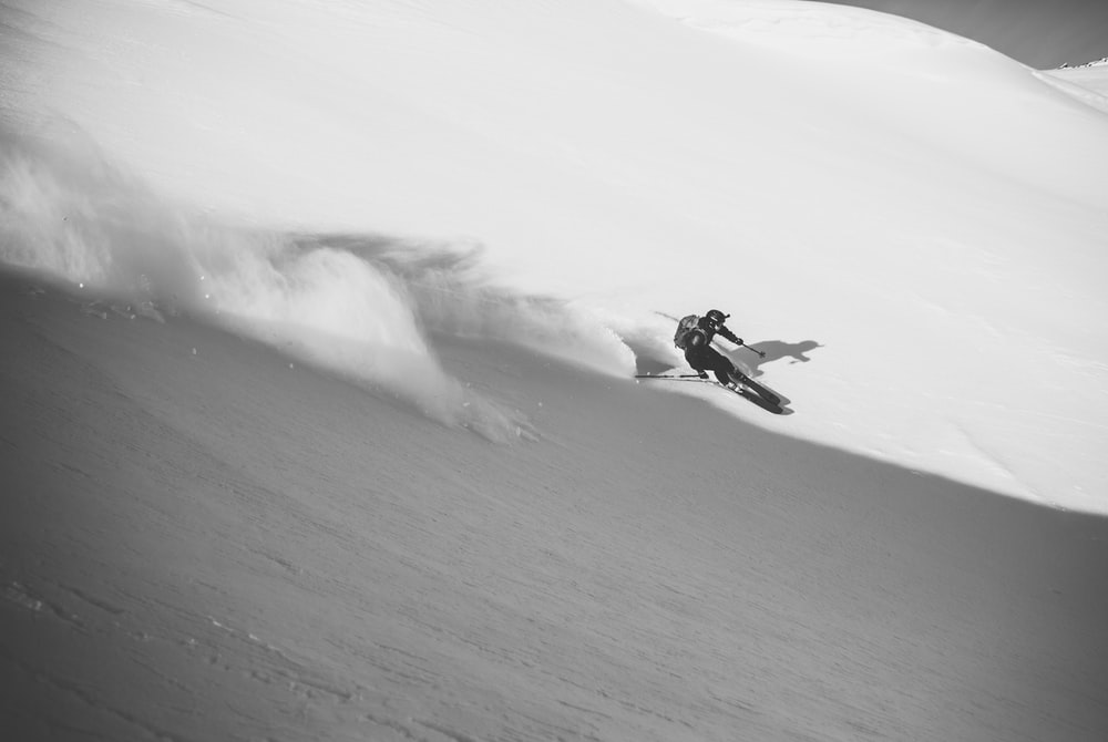 grayscale photography of person playing ski
