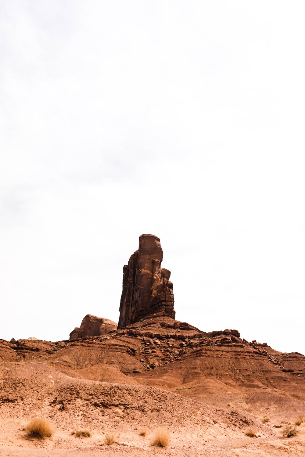 brown rock formation under white sky