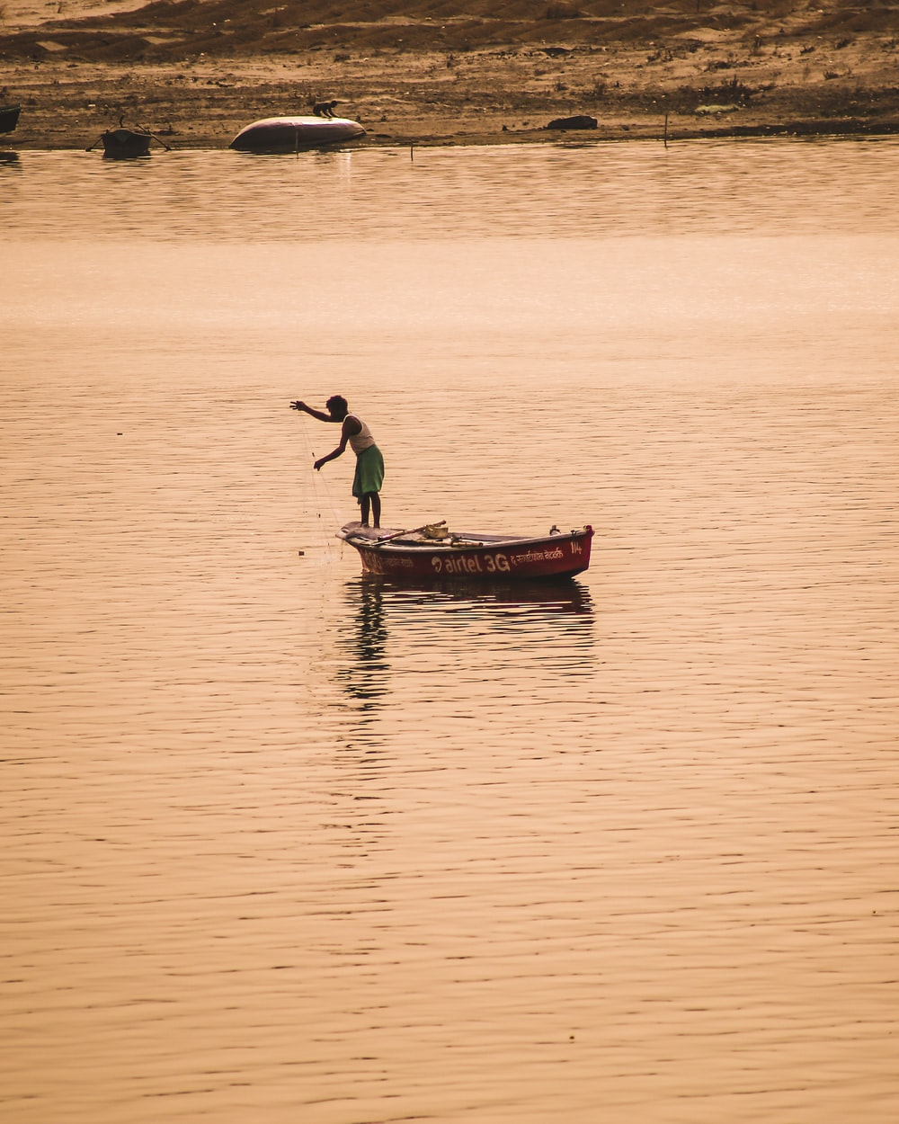 man fishing on body of water