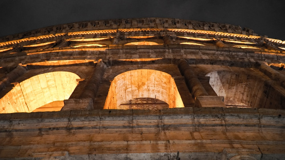 low-angle photo of lighted colloseum