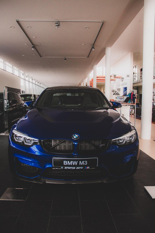 blue BMW vehicle inside building