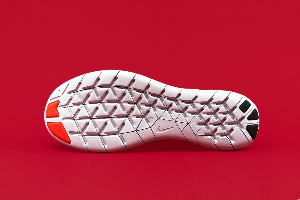 white, black, and red shoe sole