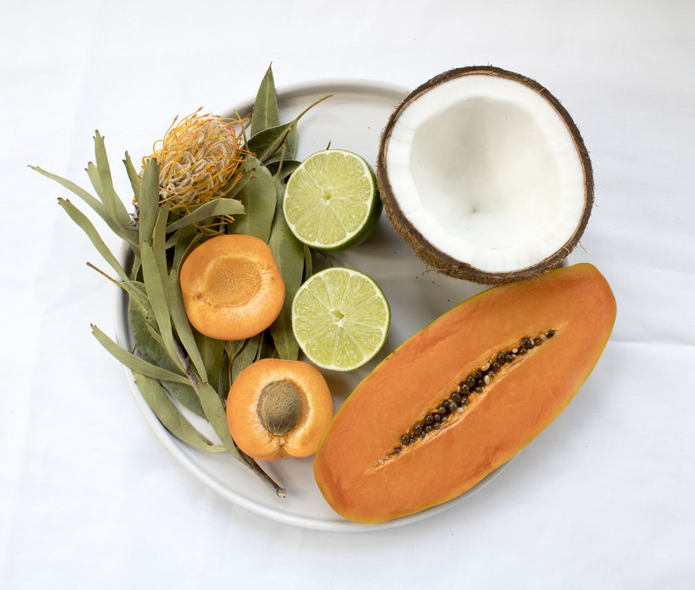 sliced fruits served on white plate