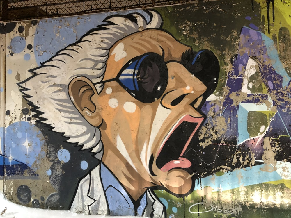 man wearing sunglasses painting