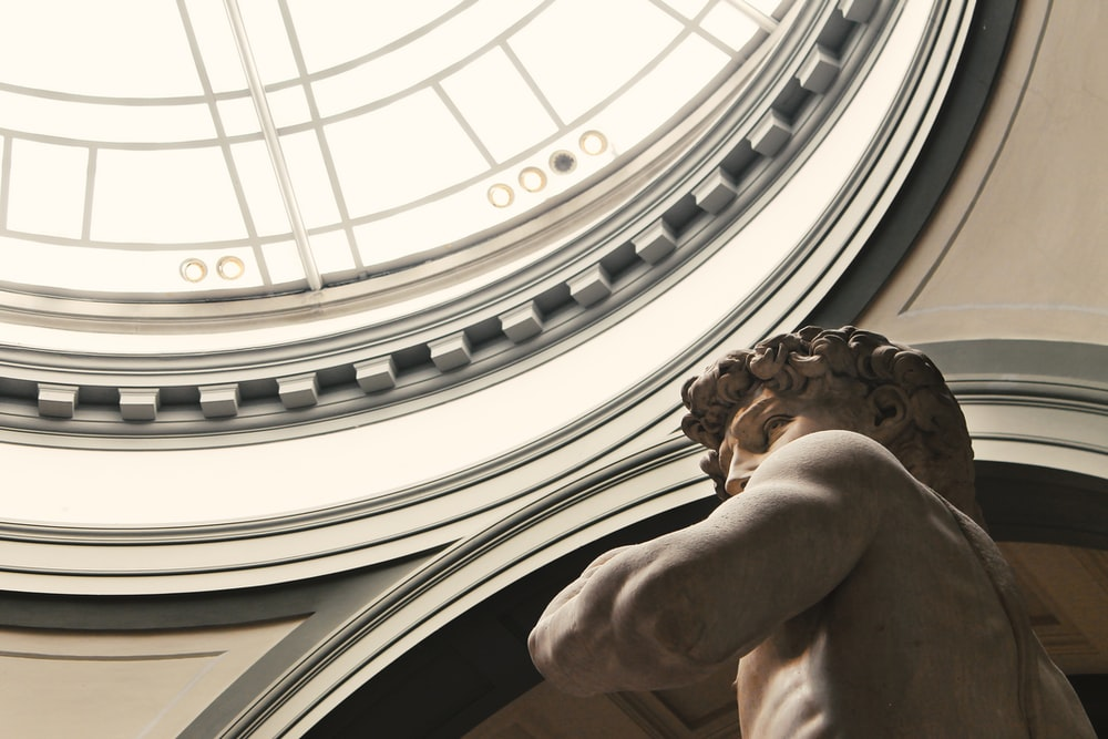 man themed statue inside dome building