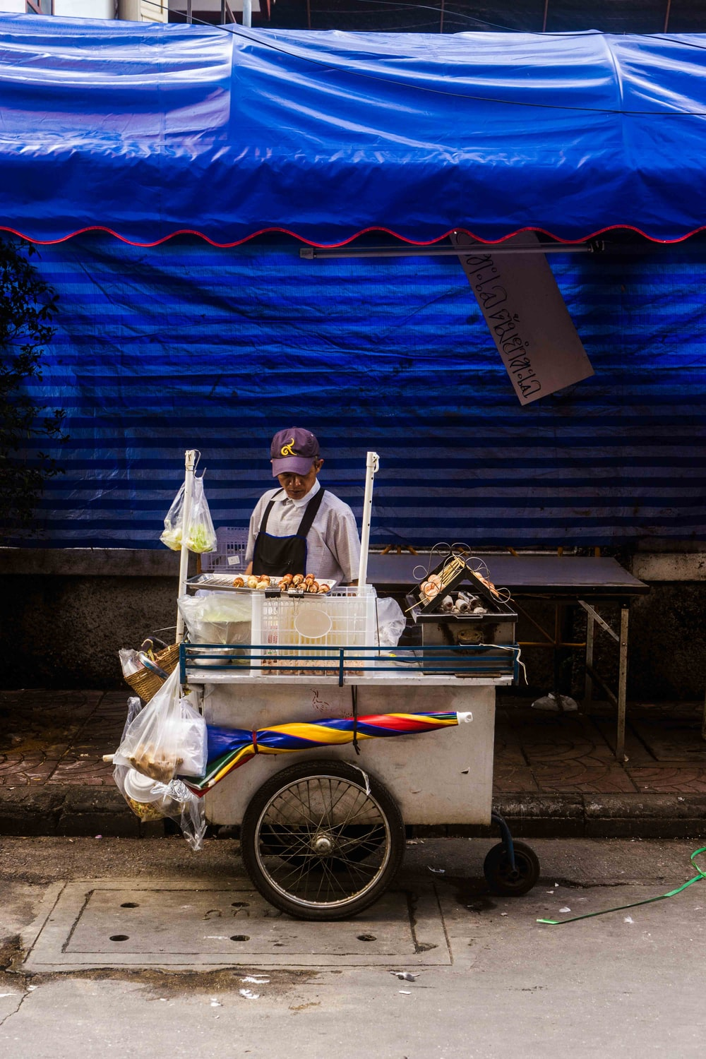 man standing in front of ice cream stall