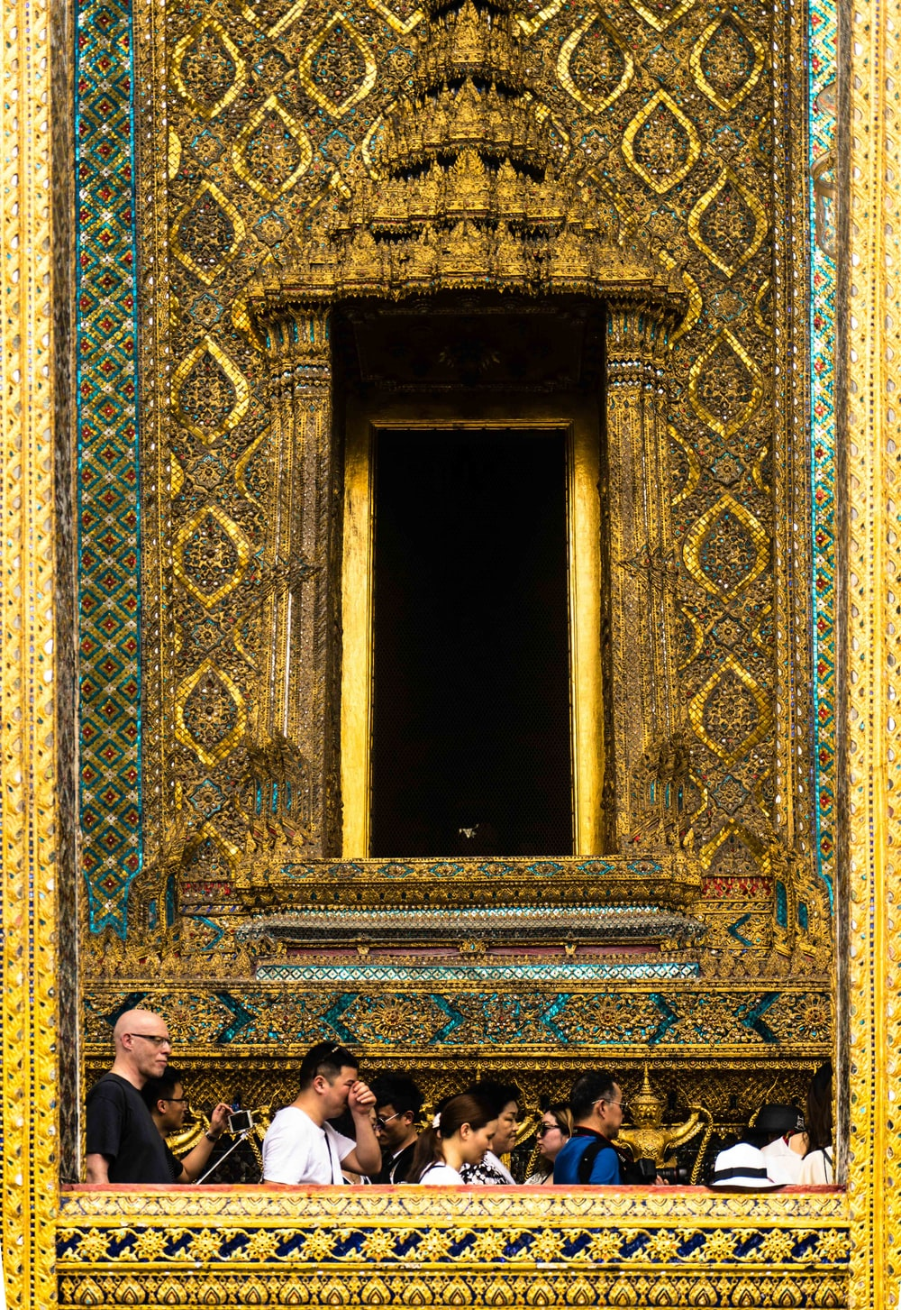 people in front of gold temple