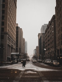 road with buildings under white sky
