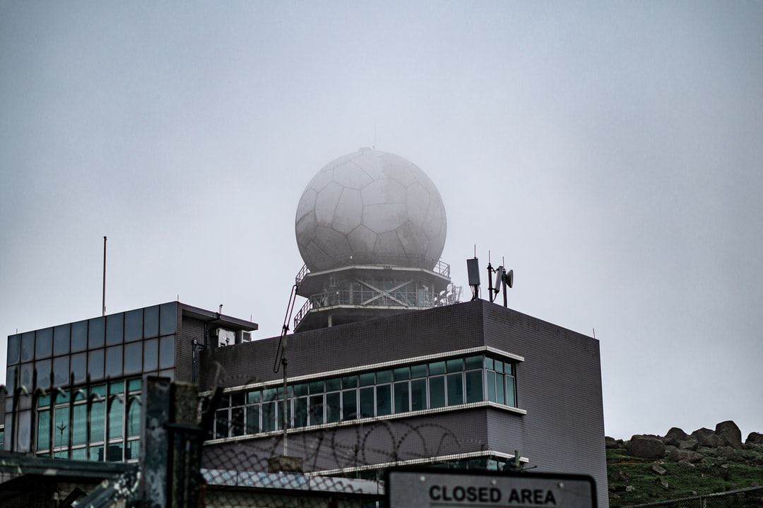 Weather radar atop a mountain on a foggy afternoon