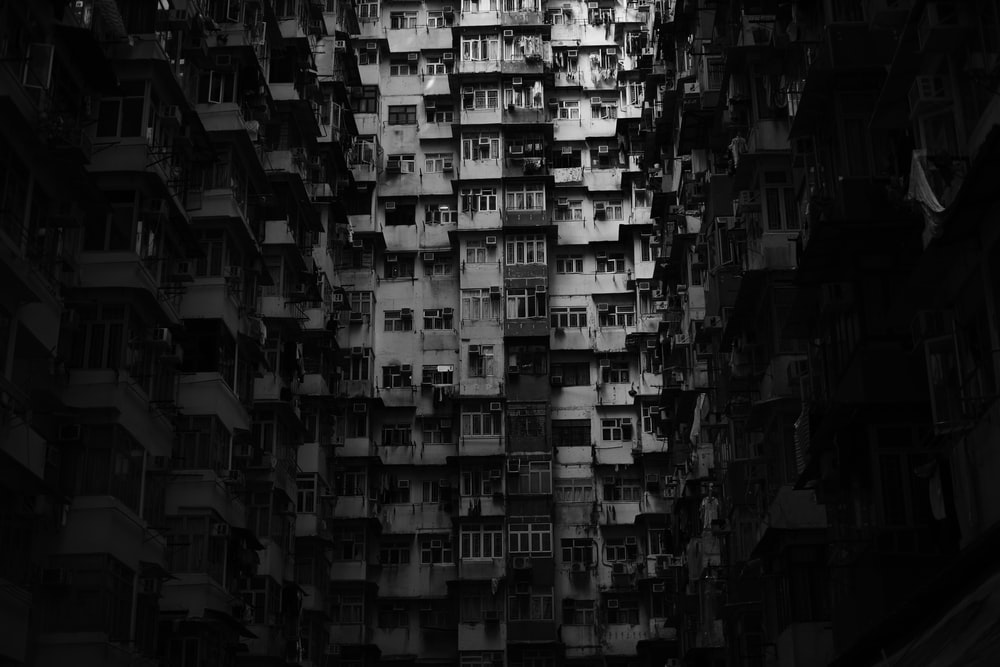 grayscale photography of multi-storey building