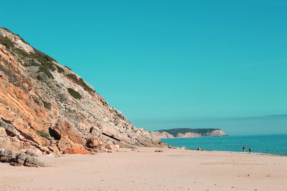 rock formation beside sea