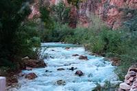 cascading river beside mountain