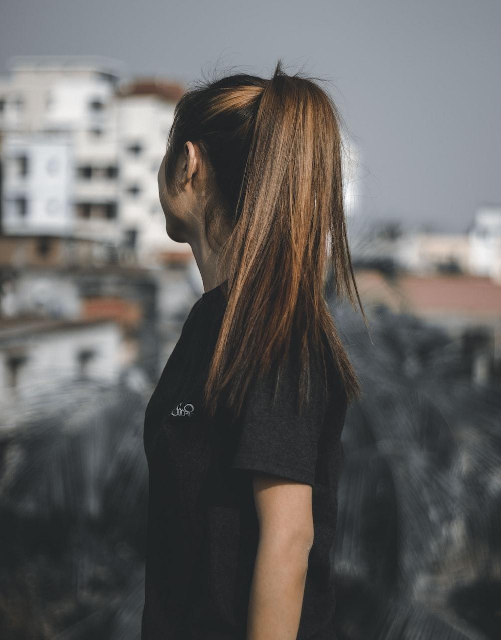 woman looking sideward during daytime