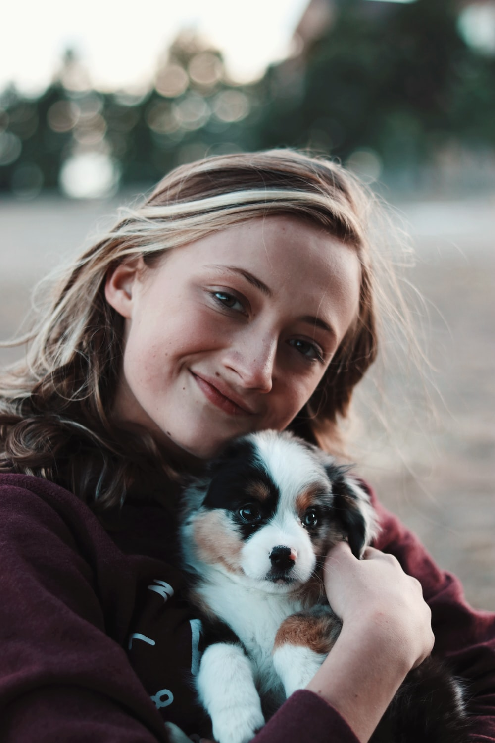 smiling woman hugging puppy