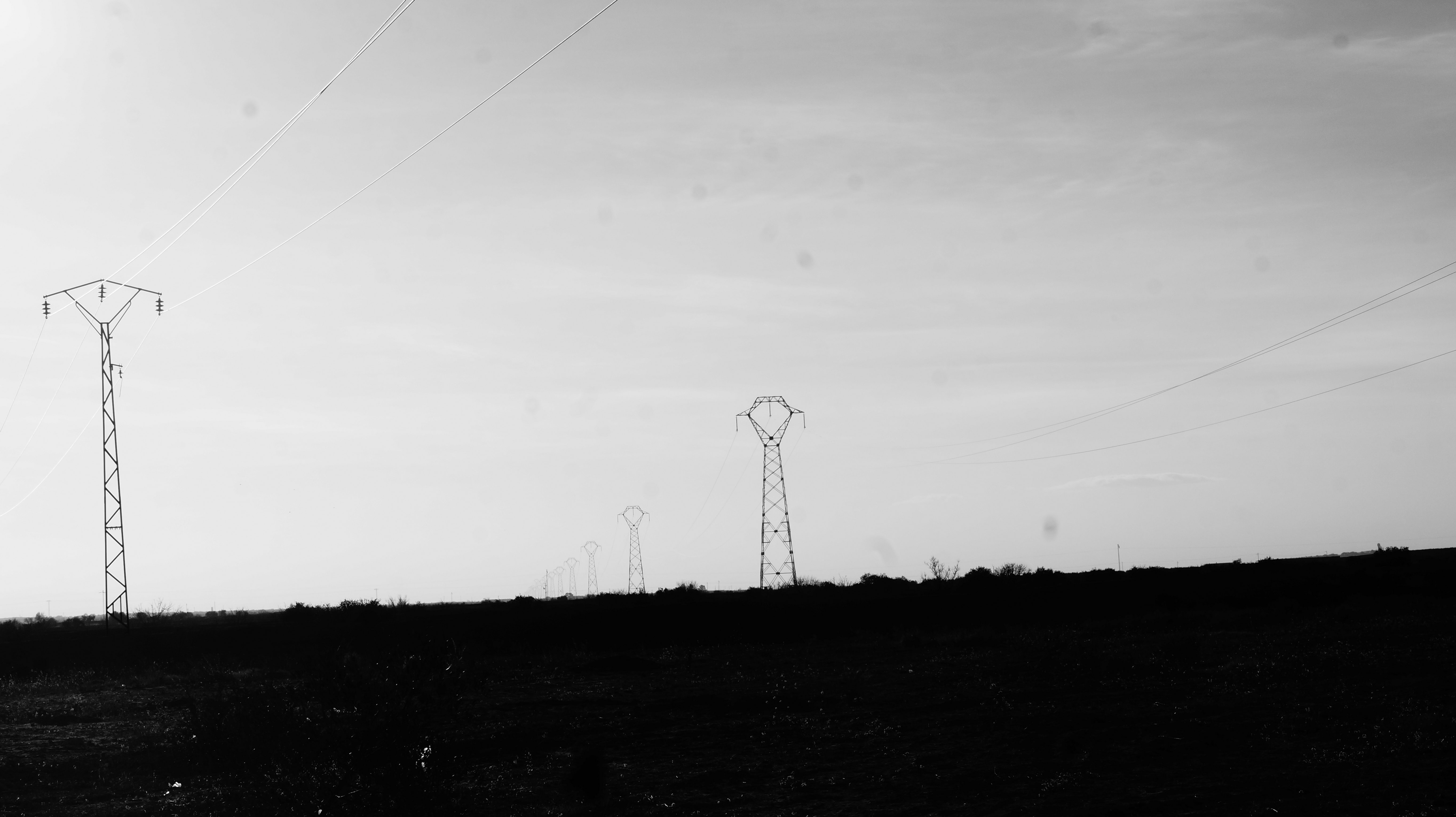silhouette photo of transmission network