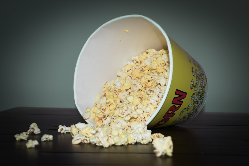 popcorn being poured from cup