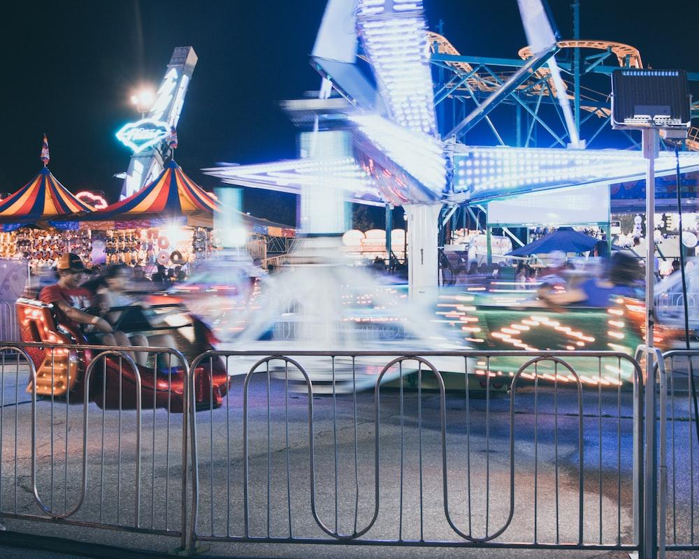 people riding on amusement rides