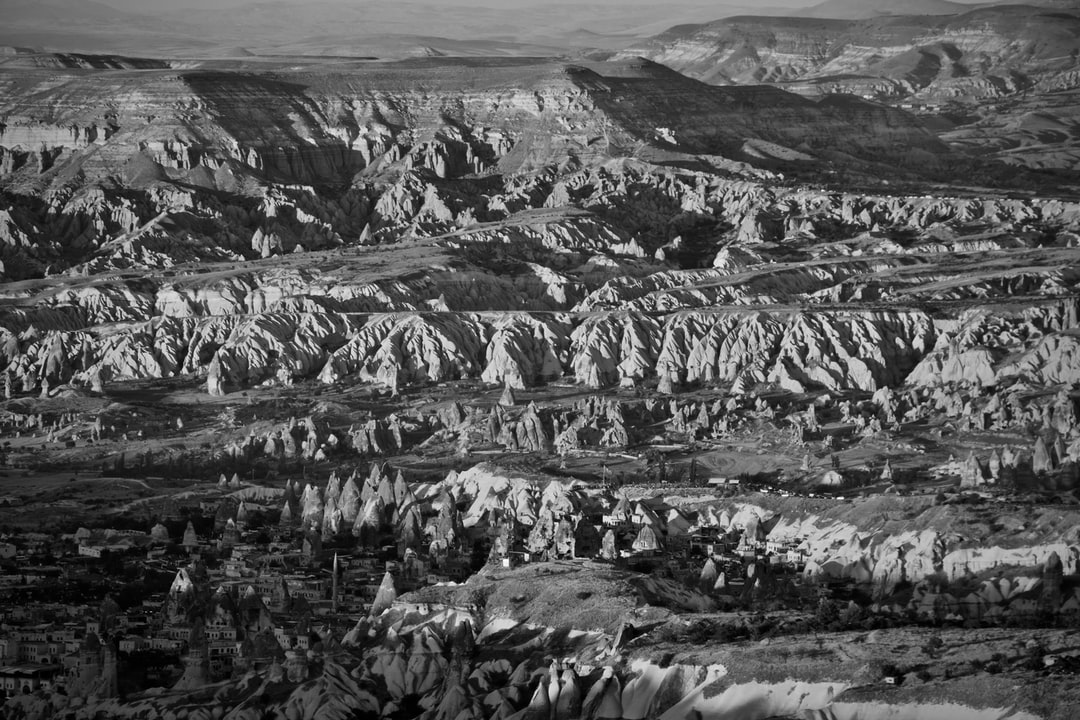 """After a slightly stressful journey from Konya, I arrived in my stay in Cappadocia, and that evening literally raced up the steep town of Uçhisar to reach the peak of the rock castle  at the town's summit. I took plenty of photos of the sunset and the golden hillsides, but this is one of my favourites, as it showcases the remarkable geological features that make the Cappadocian landscape so unlike anywhere else in the world: jagged clefs and shadowy """"chimneys"""" set against broad layers of weathered sandstone, worn away through years of trampling under hooves and the carving of human ingenuity."""