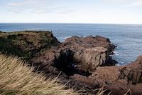 brown beach cliff viewing calm sea