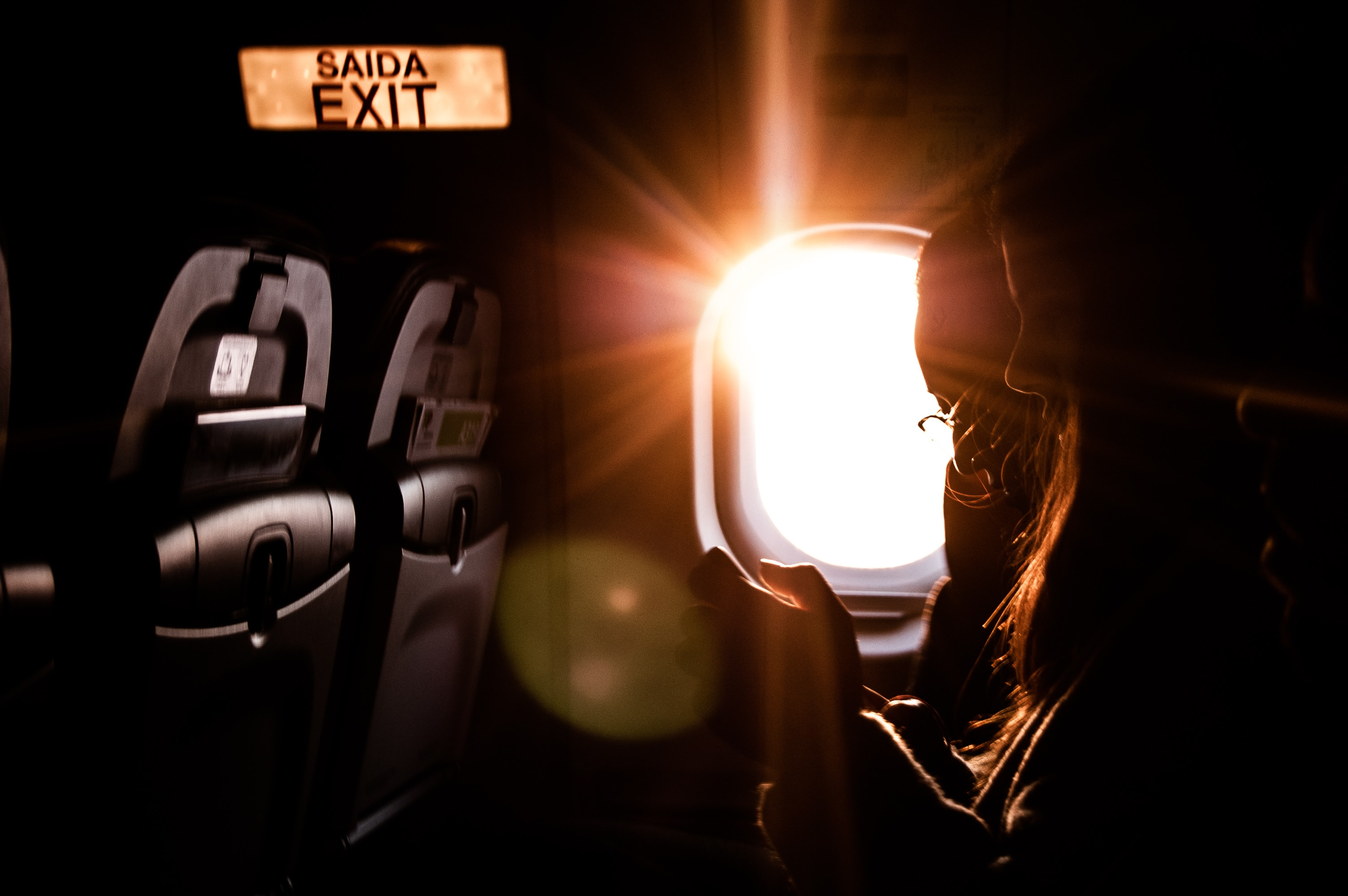woman inside plane on focus photography