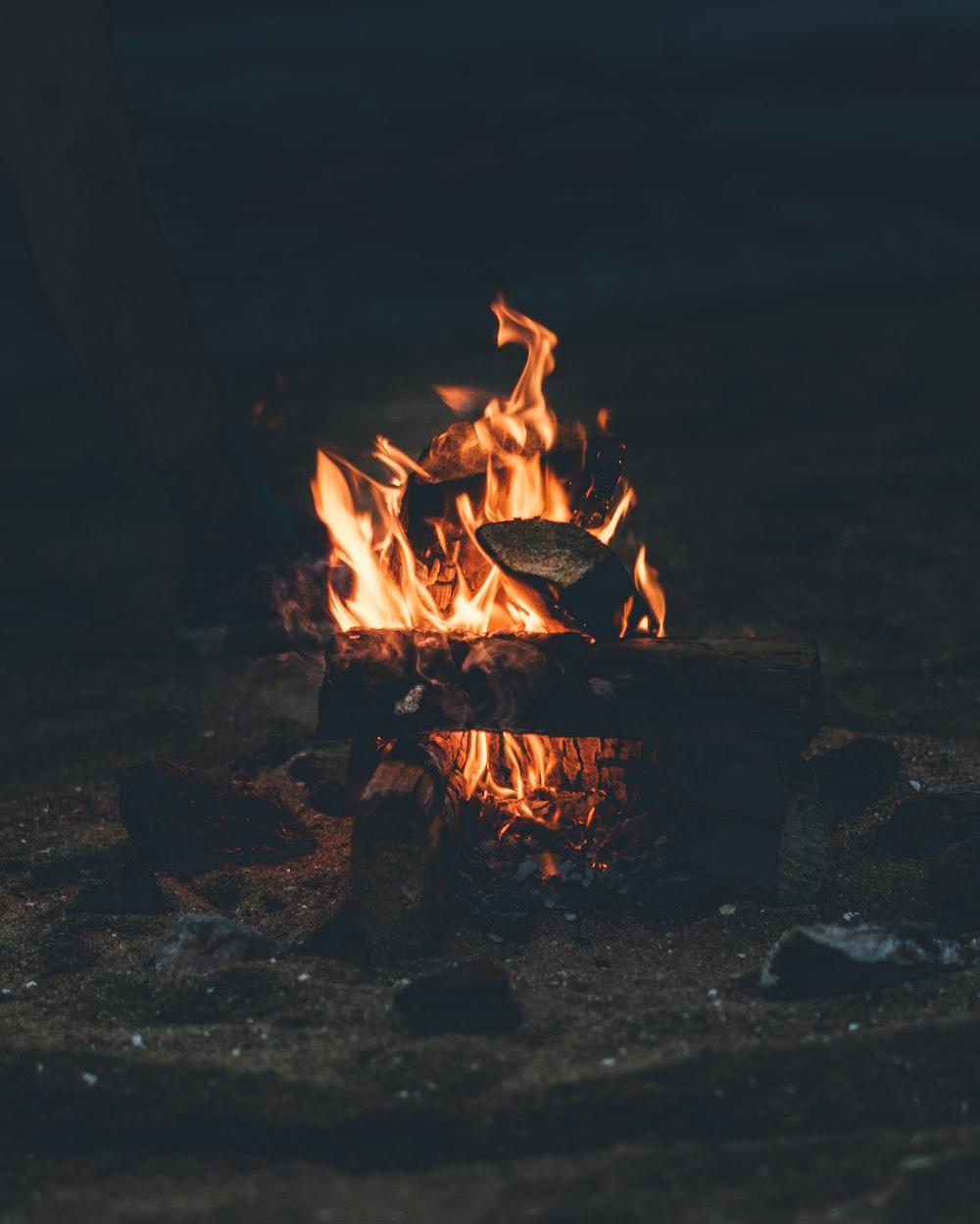 flaming bonfire on grey sand