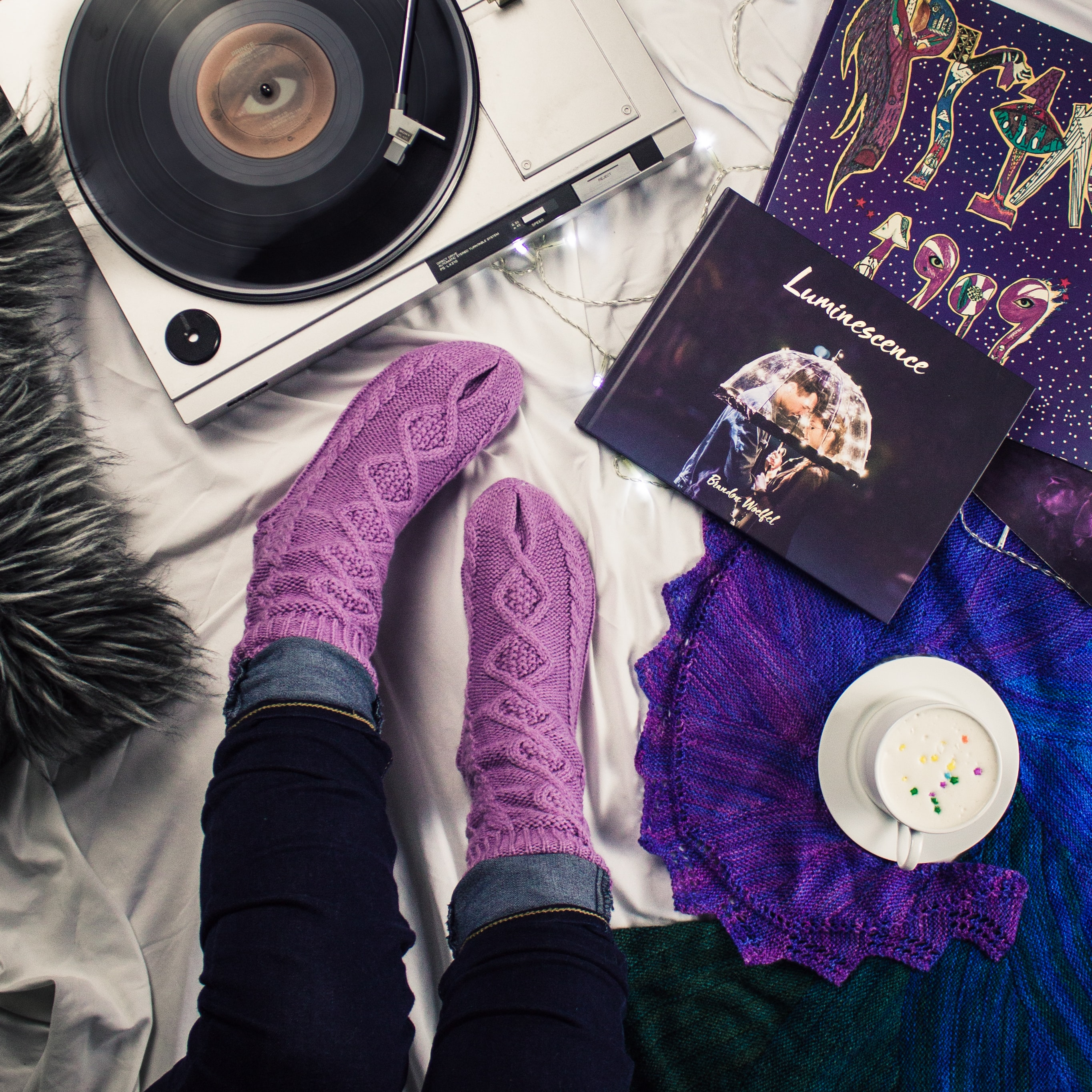 woman's purple socks near turntable