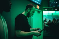 man holding game pad while shouting inside room