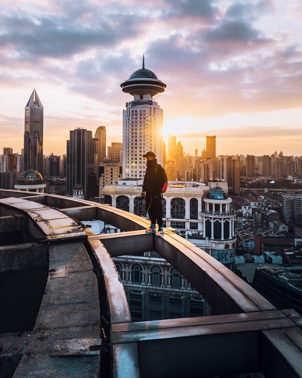 man standing on building edge