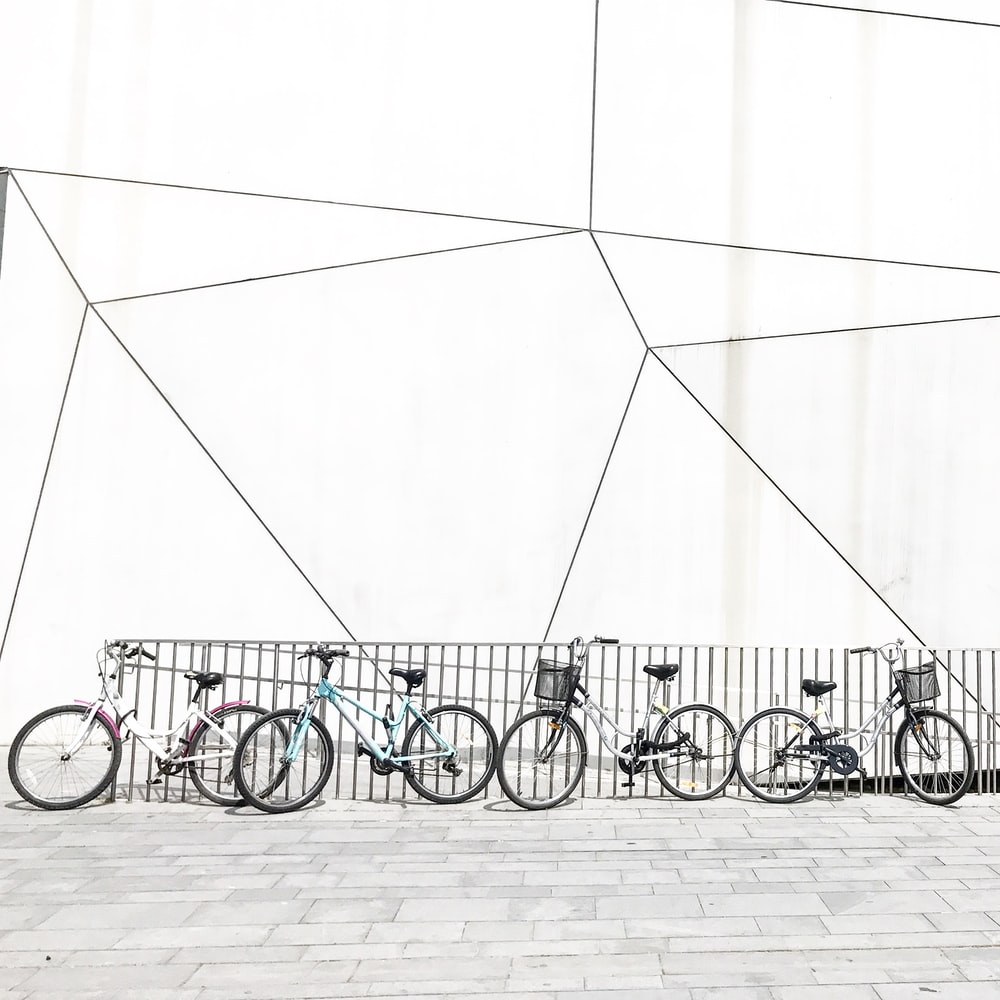 bicycles beside railings