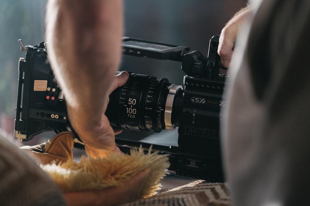 shallow focus photo of black video camera