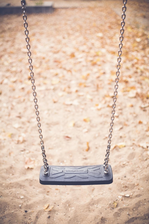 vacant gray outdoor swing