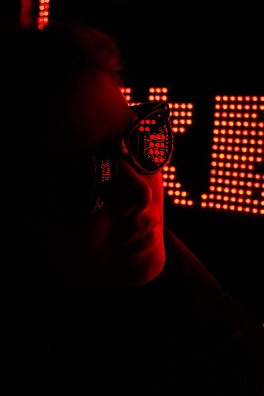 man wearing sunglasses on dark room