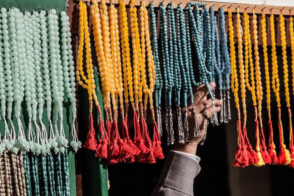 person touching prayer beads