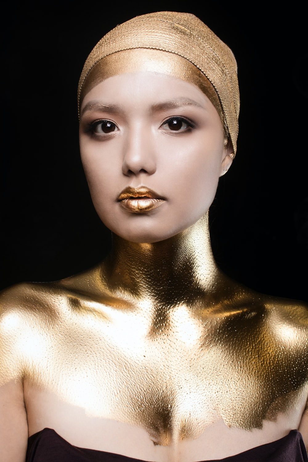woman's body covered in gold color