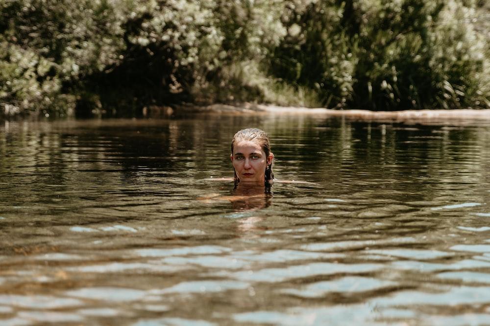 woman swimming at river