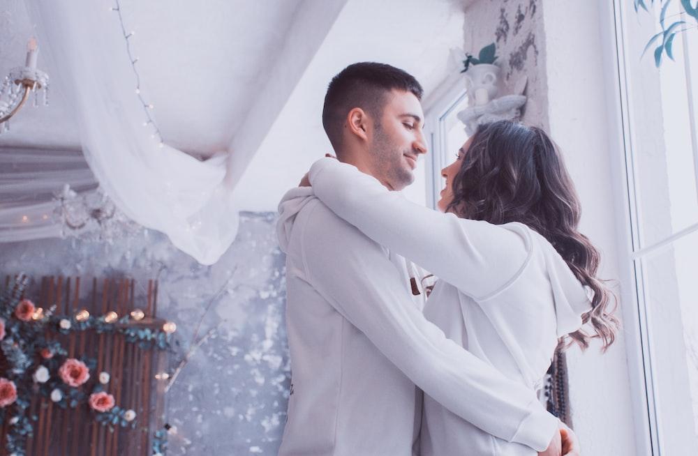 smiling man and woman hugging