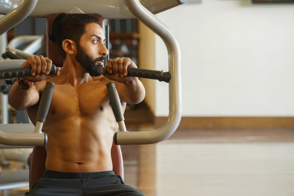 man sitting on exercise machine