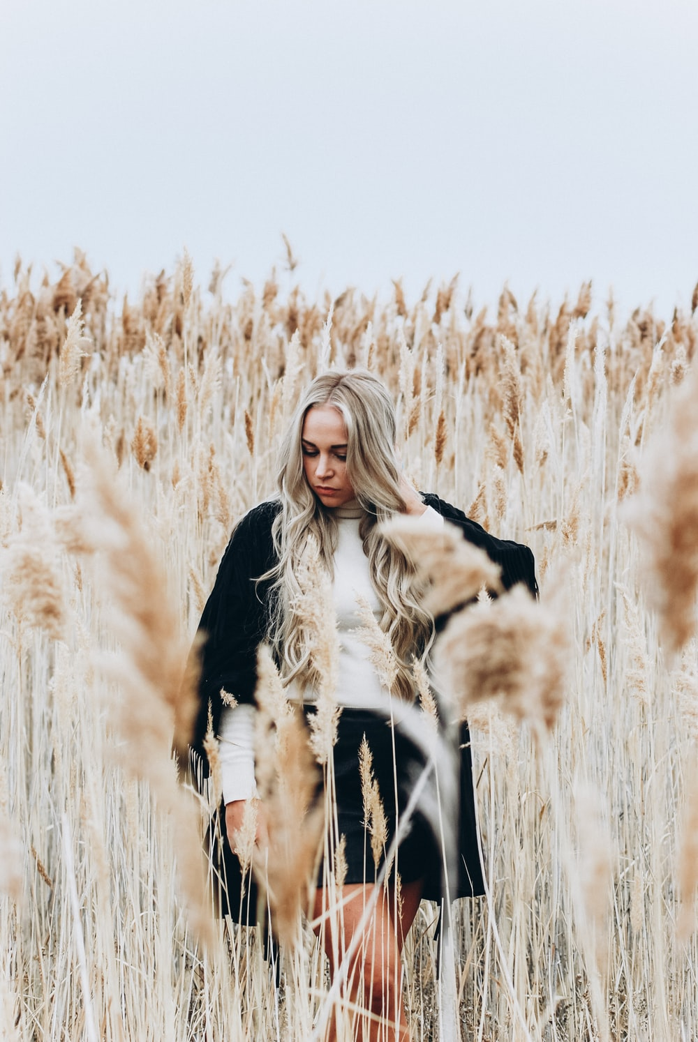 woman standing in wheat covered area