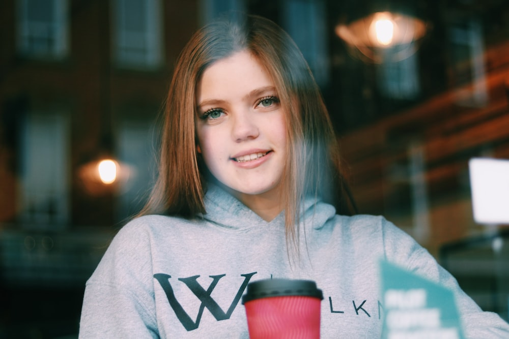 smiling woman inside coffee shop