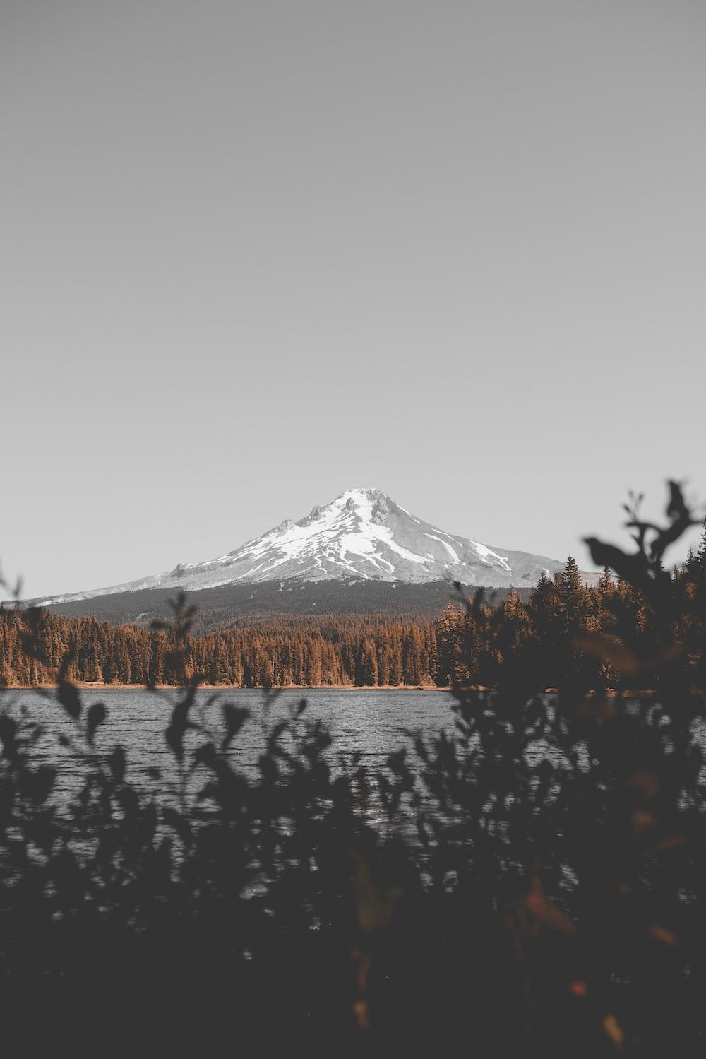 lake near snow mountain range