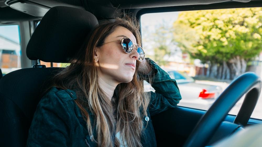 woman sitting inside vehicle during daytime