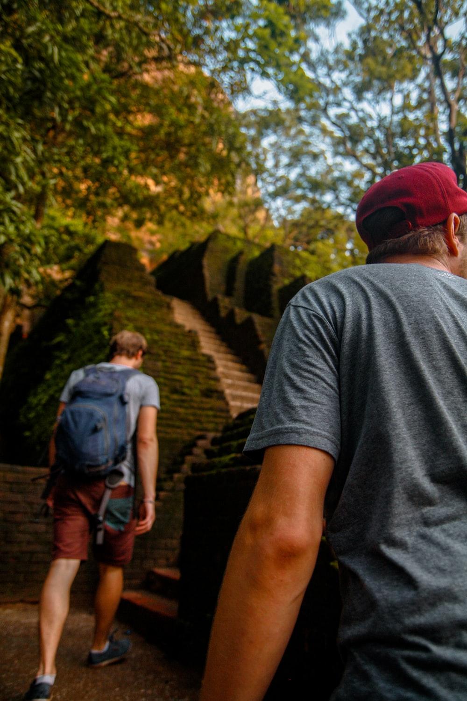 two men walking upward