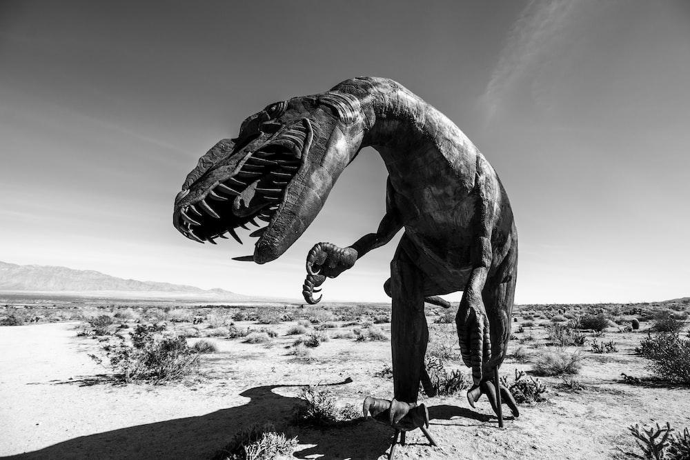 gray scale photography of Dinosaur decor