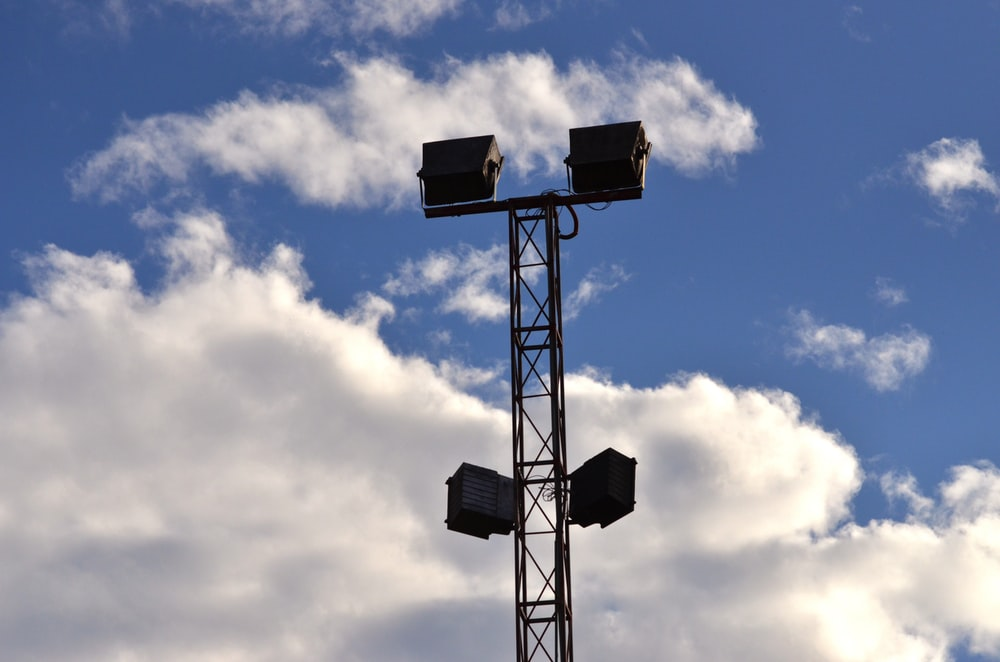 black metal tower under blue and white sky
