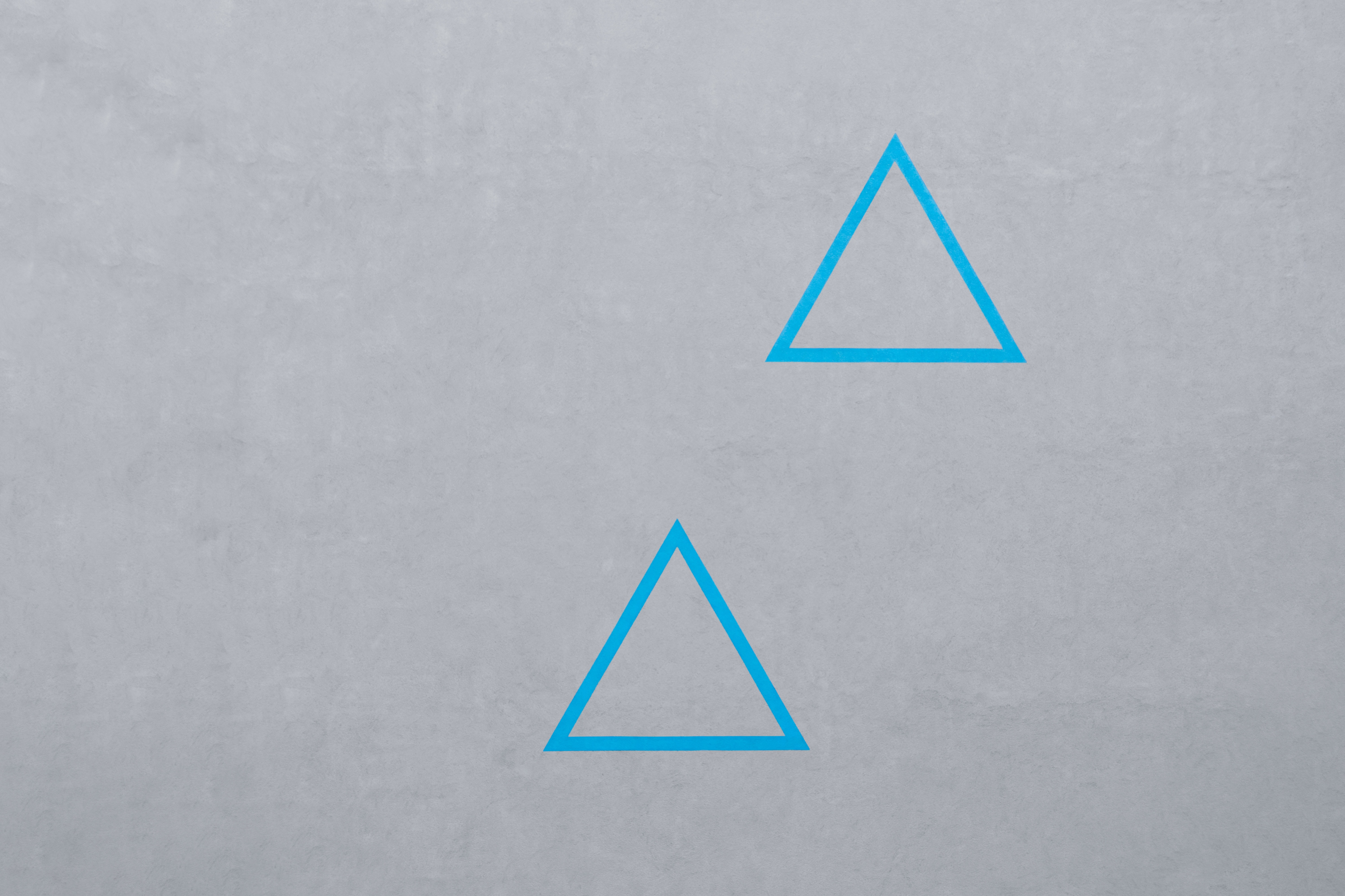 two blue triangle logos