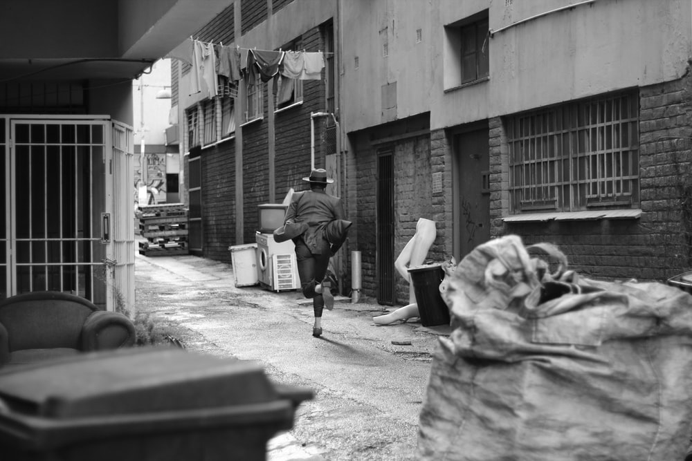 person running along alley